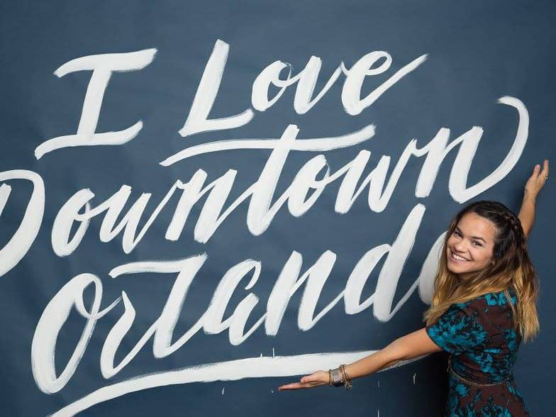 I Love Downtown Orlando hand lettered backdrop for DOP Golden Brick Awards