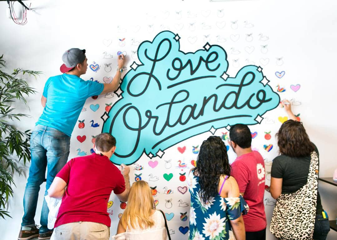 Love Orlando hand lettering by Hillery Powers mural at Orlando Shirts black teal turquoise blue rainbow