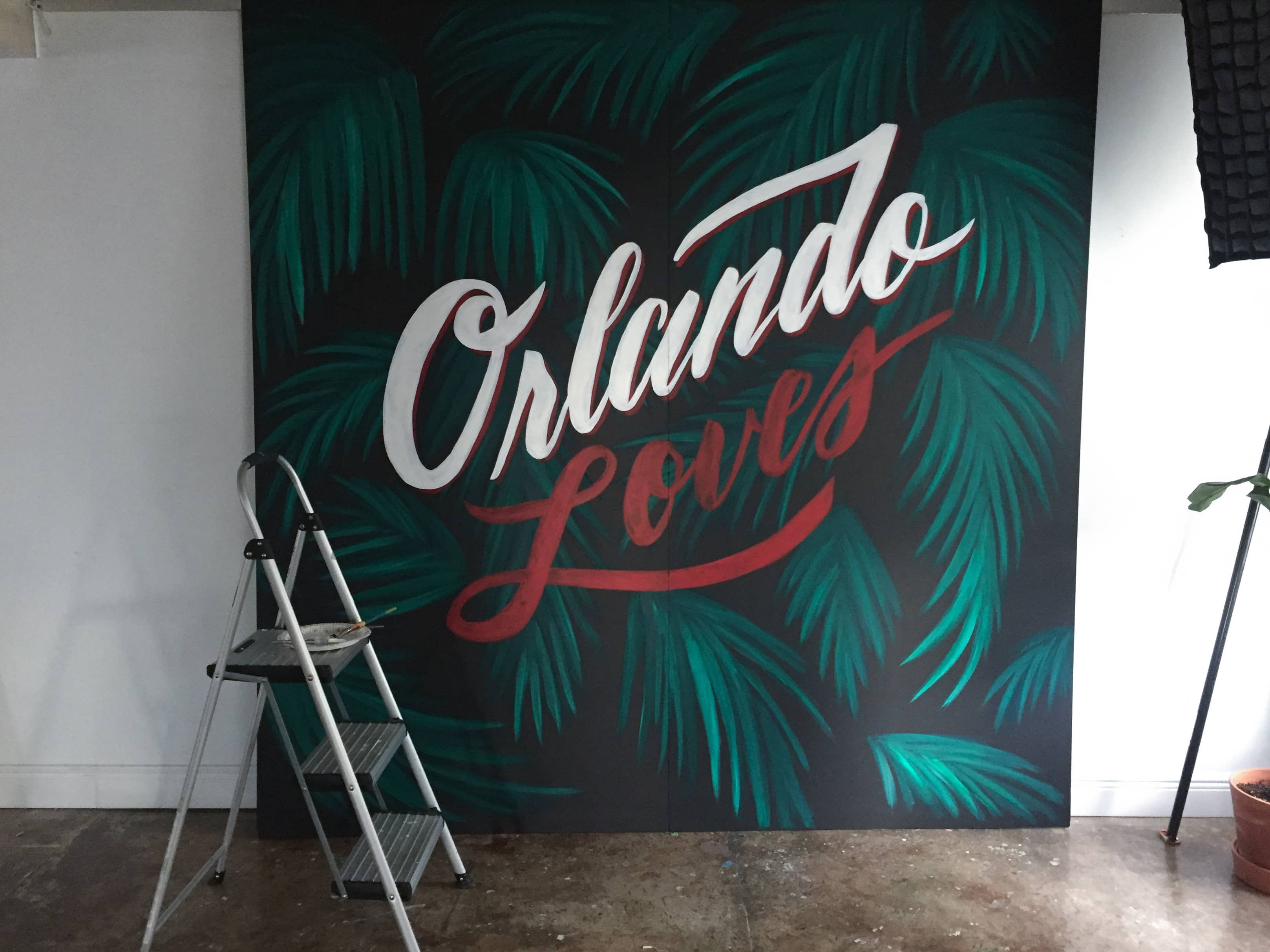 Orlando Loves hand lettering by Hillery Powers Haiti photo backdrop for Rebuild Globally