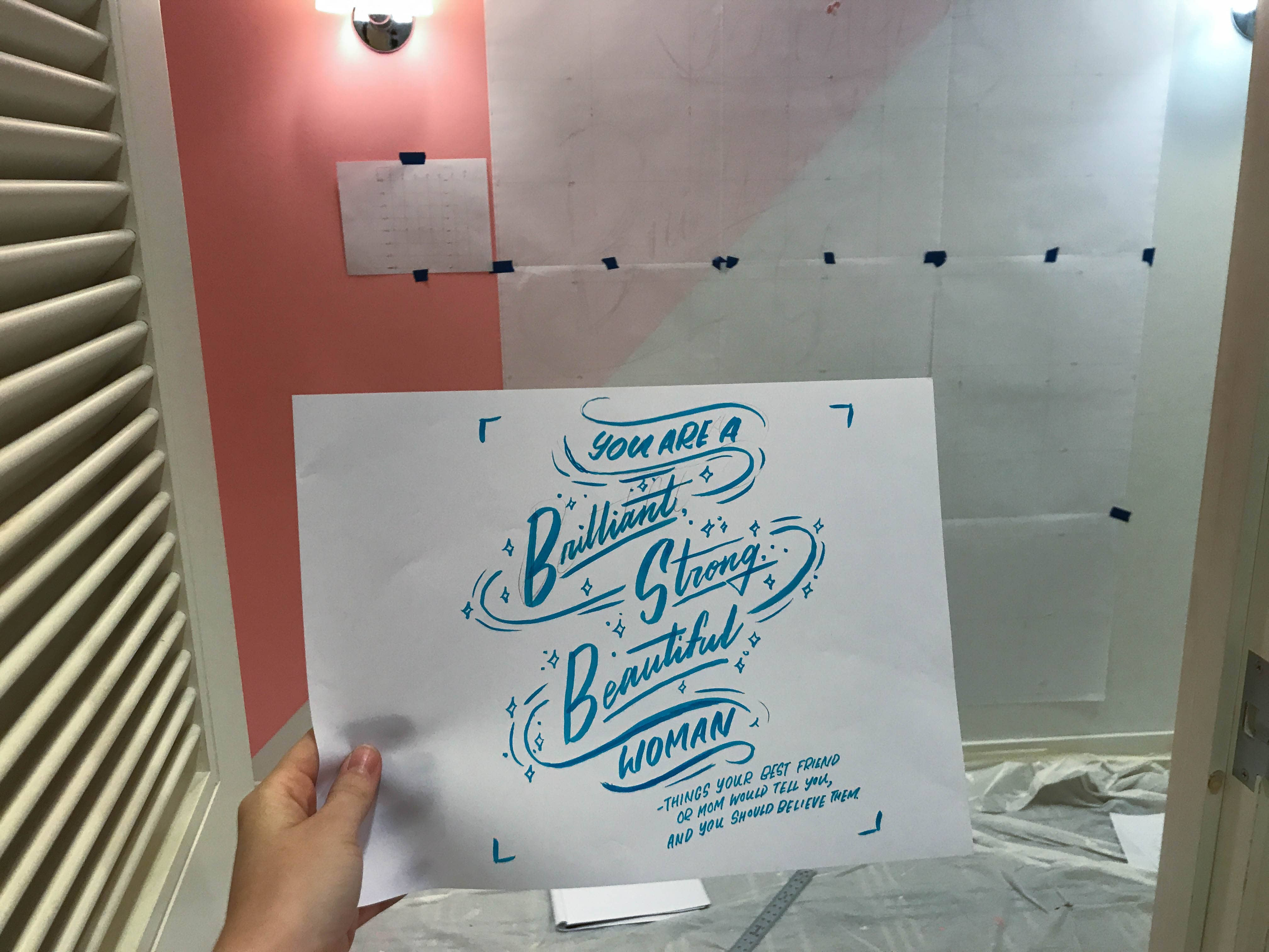 """You are a brilliant, strong, beautiful woman (and you should believe that!)"" hand-lettering by Hillery Powers Bloomingdales Mall at Millenia fitting room mural pink yellow white black"