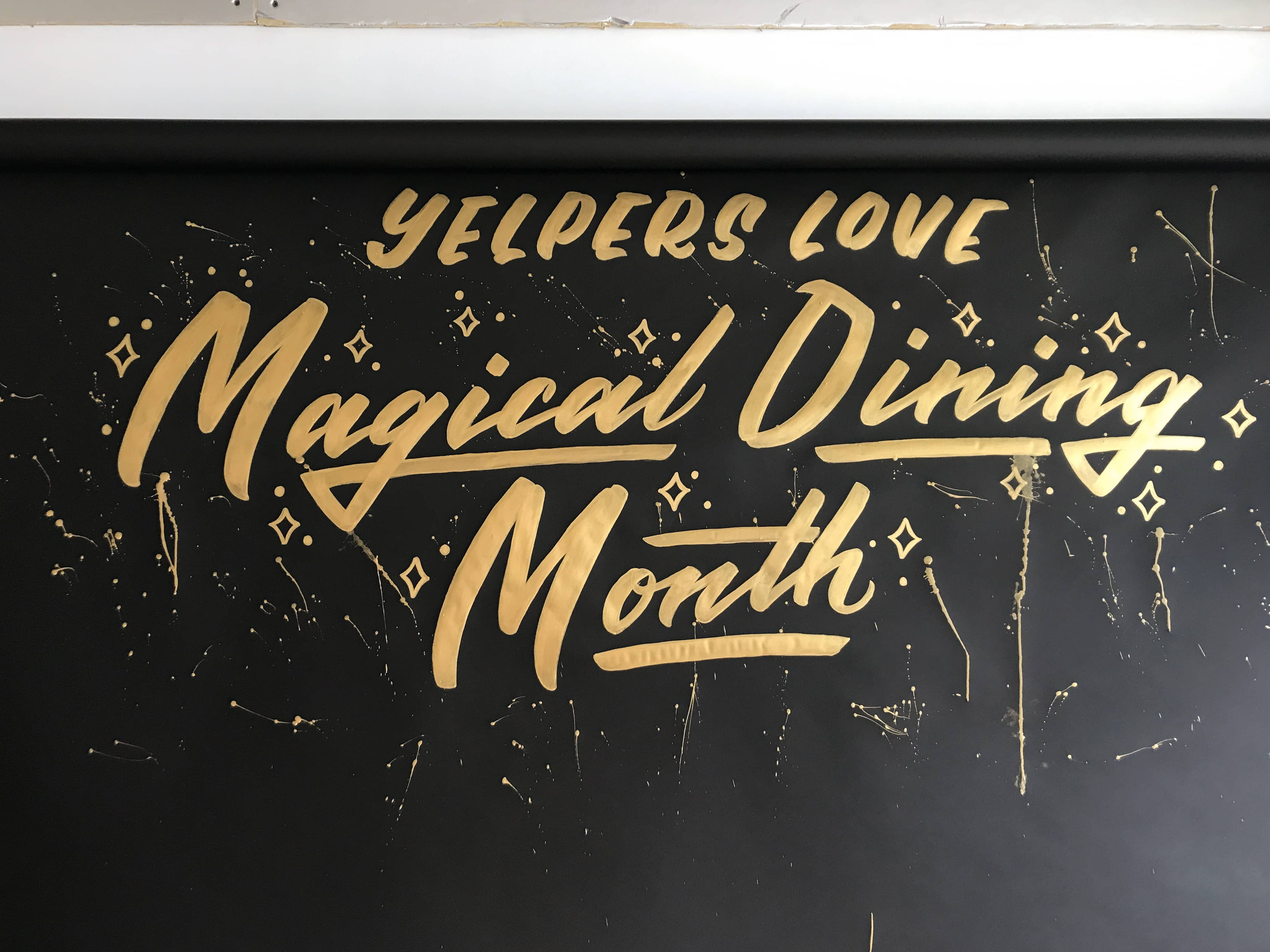 Yelp Magical Dining Month hand lettering by Hillery Powers photo backdrop in Millenia Mall