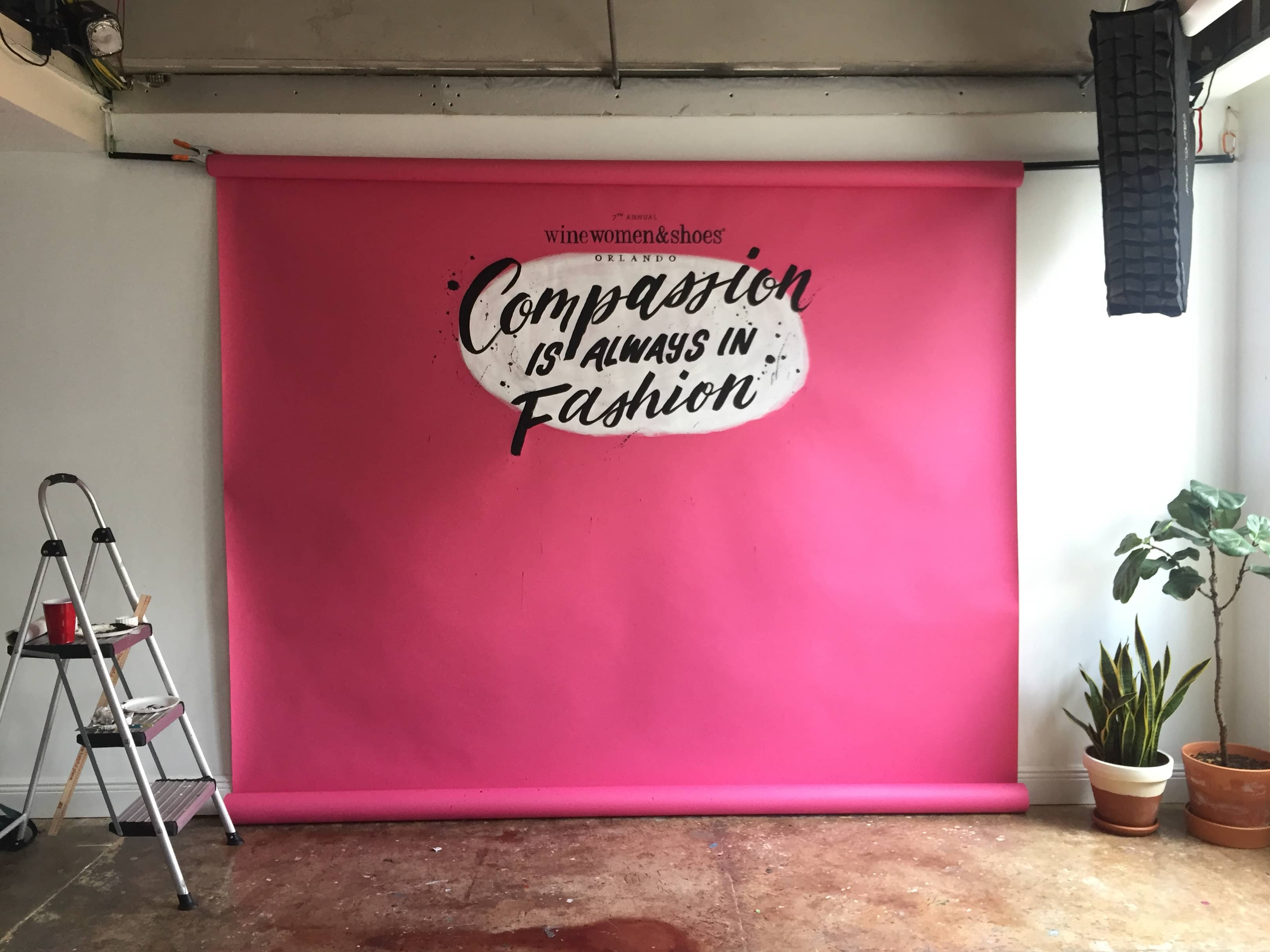 Compassion is Always in Fashion hand lettered backdrop for Wine Women and Shoes Orlando