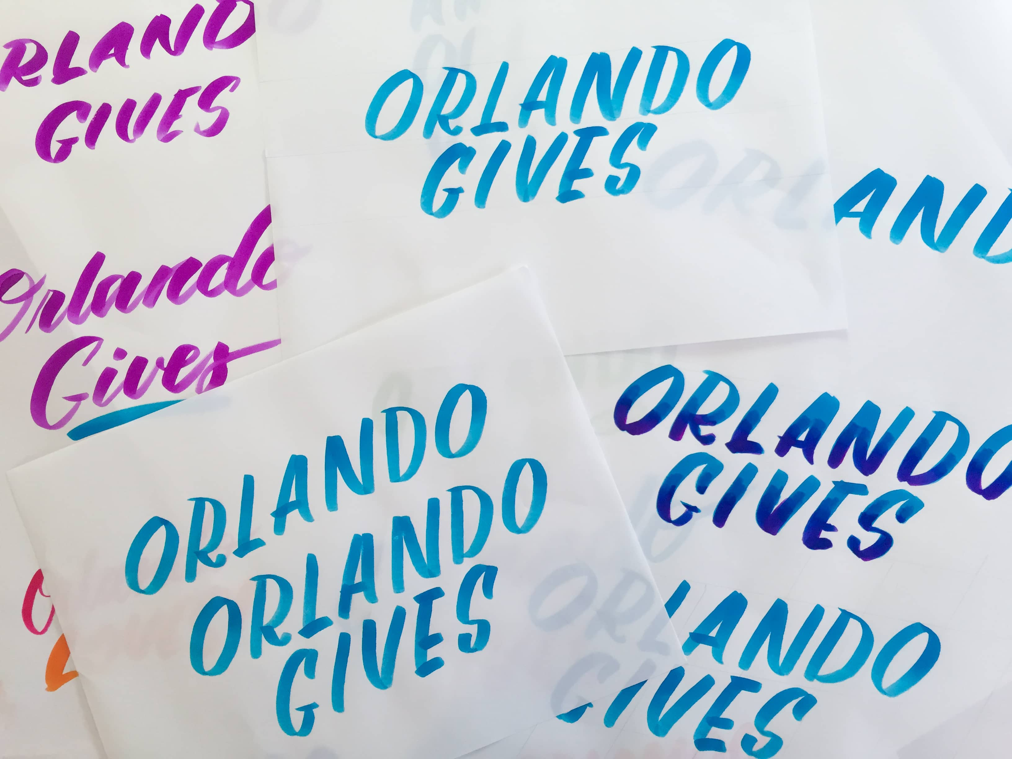 Orlando Gives hand-lettering by Hillery Powers constellation mural for Rethink Homelessness blue pink white