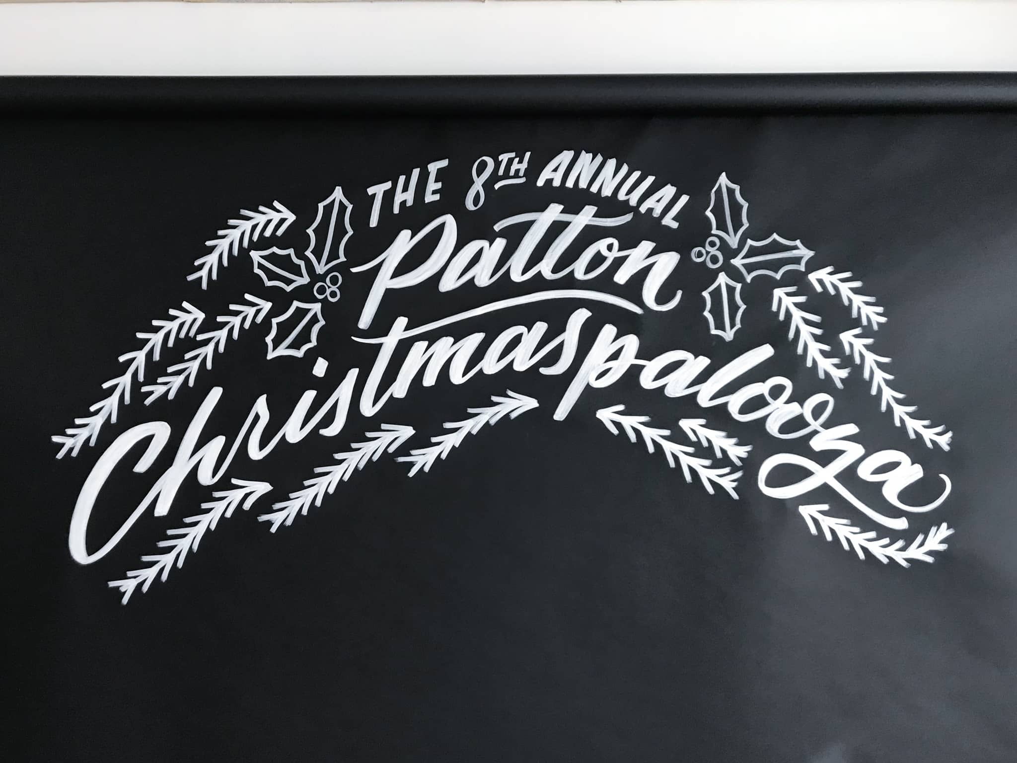Hand painted holiday photo booth backdrop with brush lettering by Hillery Powers