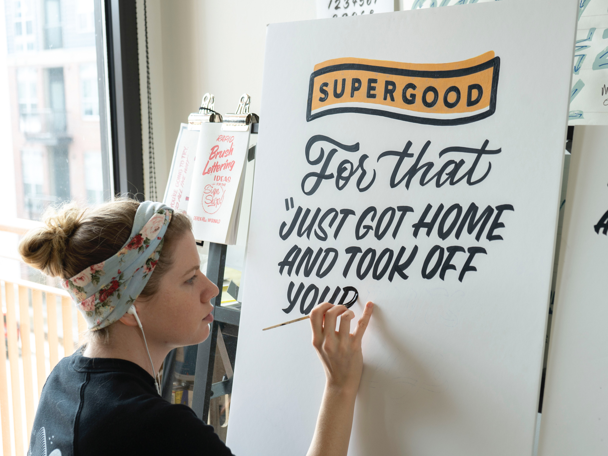 Hand painted sign for Supergood Hemp sign painted by Hillery Powers
